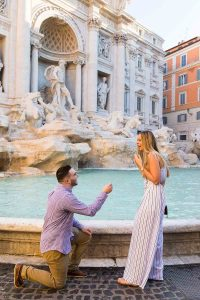 Surprise wedding proposal in Rome at the Trevi fountain