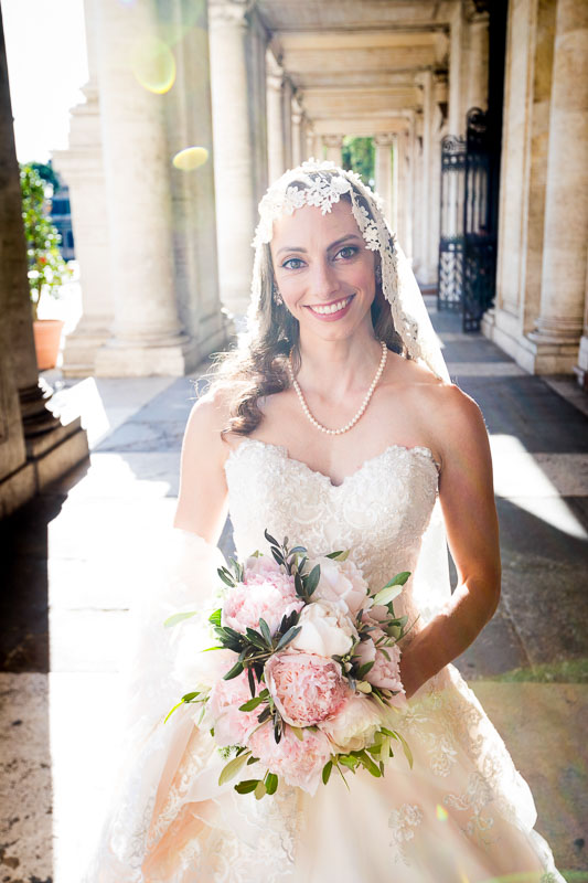 Beautiful bridal portrait taken in Piazza del Campidoglio in Rome Italy before entering Town Hall