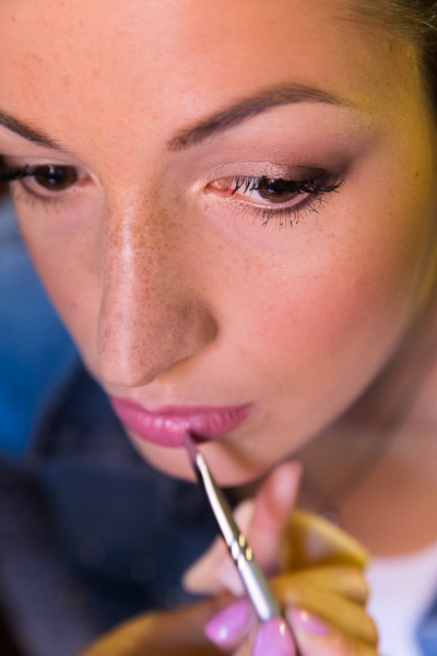 Woman close up during the lip gloss application and preparation