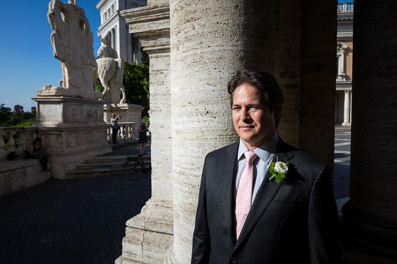 Groom portrait under ancient marble columns