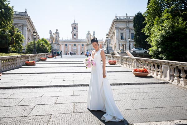 Bride standing on the staircase leading into Capidoglio square