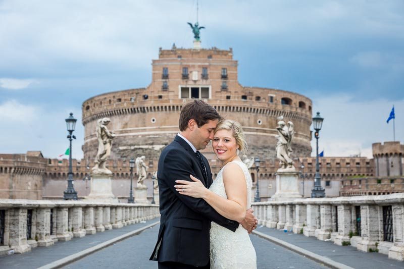 Just married taking pictures on the Castel Sant'Angelo bridge and castle