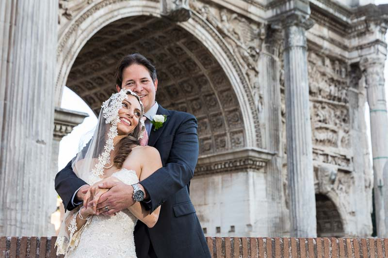 Nuptial portrait under old arch
