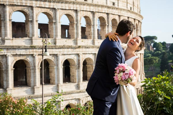 Bride and groom taking nuptials pictures at the Roman Colosseum