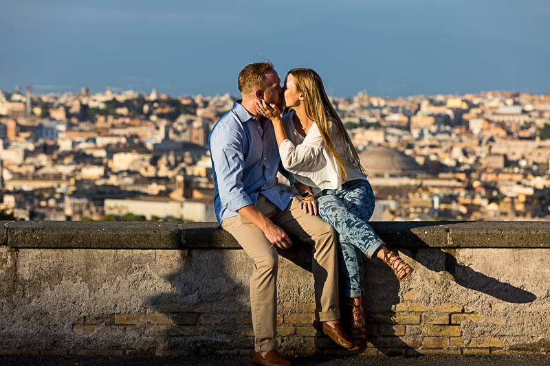 Couple kissing. In love in Rome. Surprise wedding proposal photography
