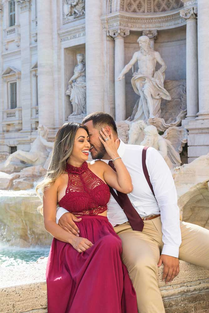Laughing and kissing while having fun during a couple photo session in Rome