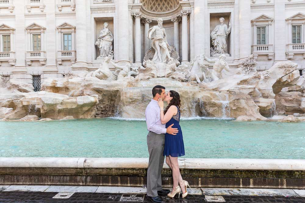 Kissing in at the Trevi fountain in Rome Italy