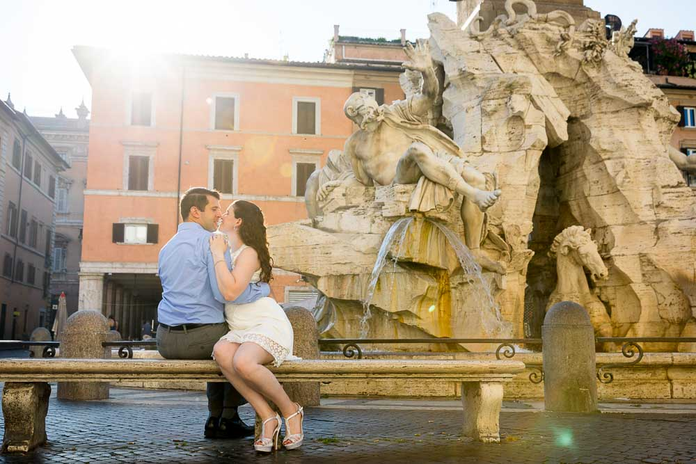 Sitting down image of a couple in love at the fontana dei 4 fiumi. Piazza Navona