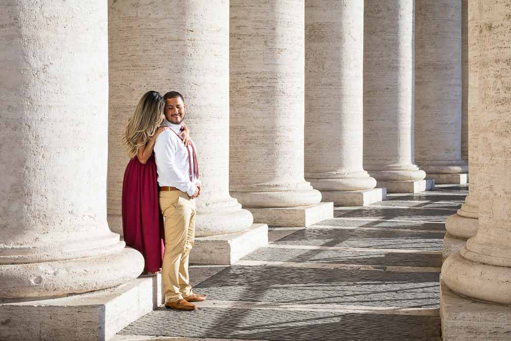 Couple portrait picture among the columns found in the St. Peter's main square