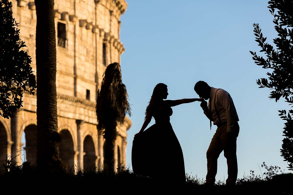 Chivalry at the Coliseum in Rome. Silhouette couple image. Photo taken at dusk after sunset. Blue hour moment