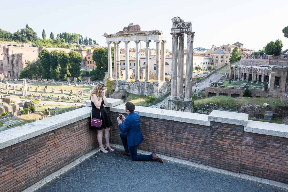 Roman Forum Proposal candidly photographed at Piazza del Campidoglio overlooking the ancient ruins in the background
