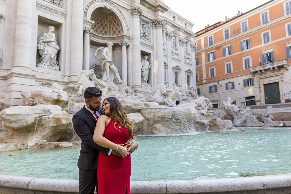 In love at the Fontana di Trevi. Water edge engagement image