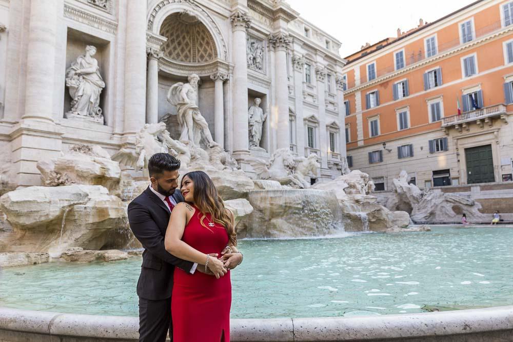 In love at the Fontana di Trevi. Water edge engagement image