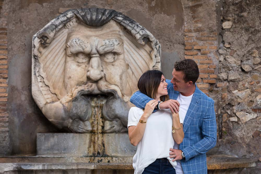 Portrait picture together before a marble water fountain statue