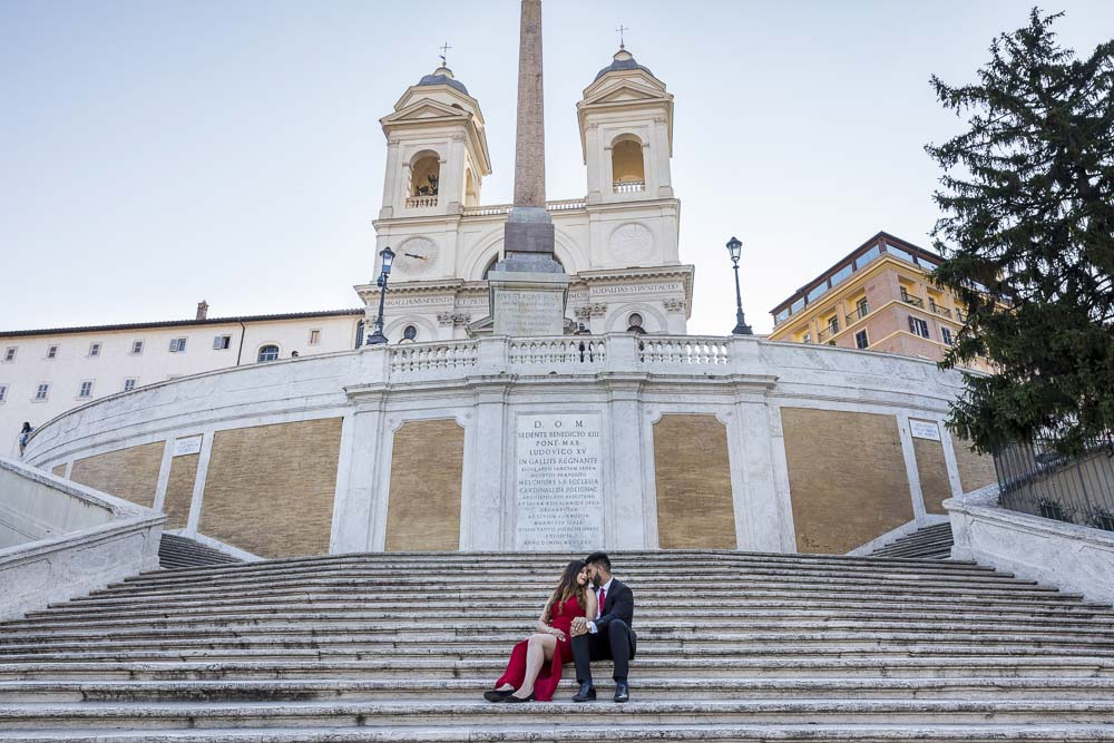 Sitting down image of a couple at Piazza di Spagna