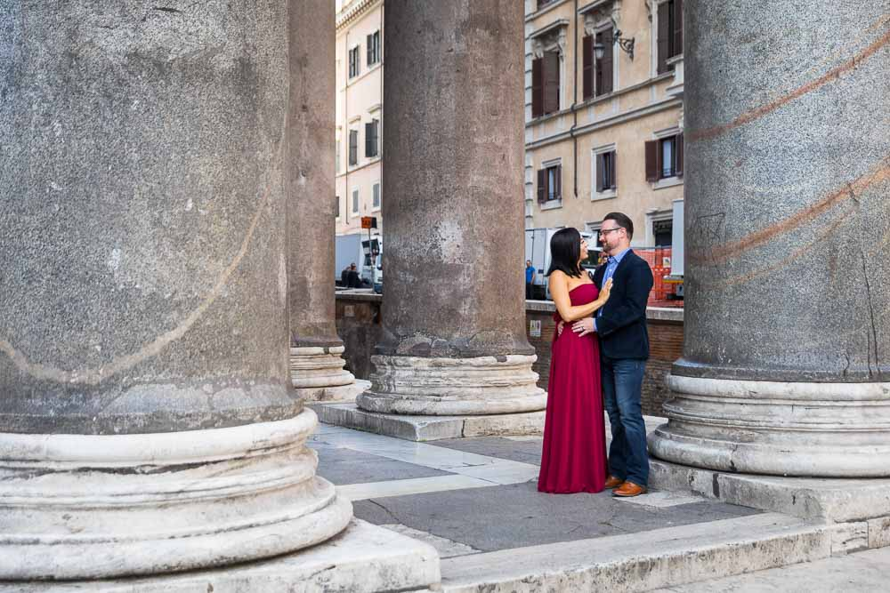 Couple standing underneath the massive Pantheon colonnade during a photography session in Rome