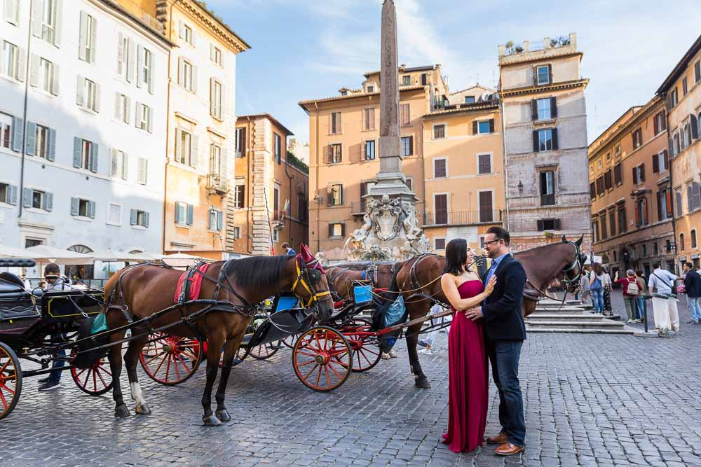 Posing before the Roman Pantheon obelisk in Piazza della Rotonda with the typical parked horse carriages