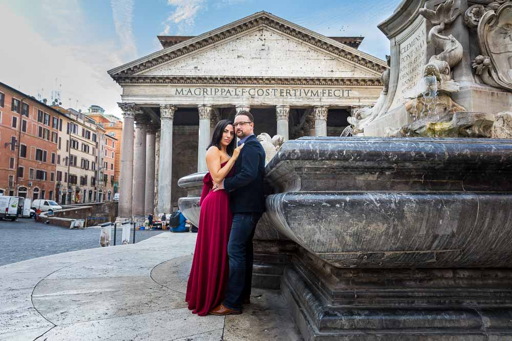 Honeymoon portrait picture standing next to the central obelisk water fountain with the roman pantheon building in the background