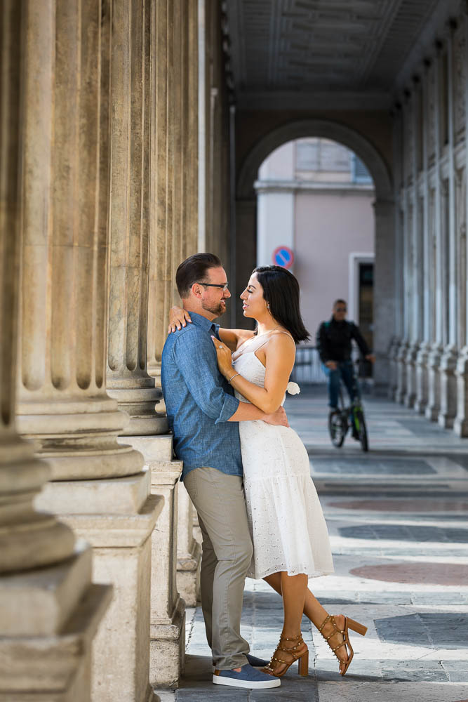 Couple posing underneath columns and arched