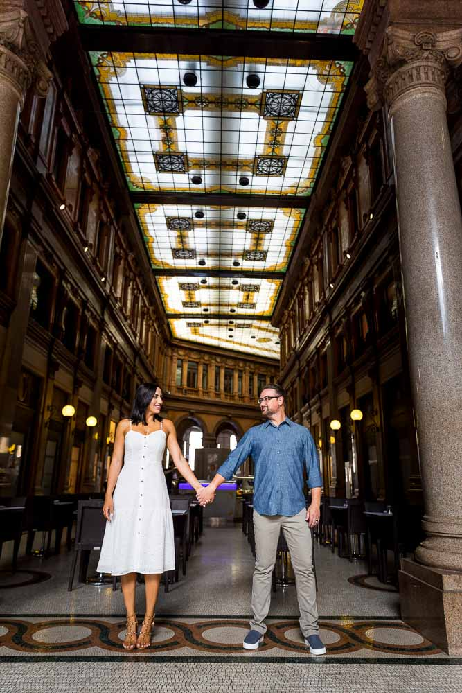 Paper dolls pose during a photo shoot in Galleria Alberto Sordi building