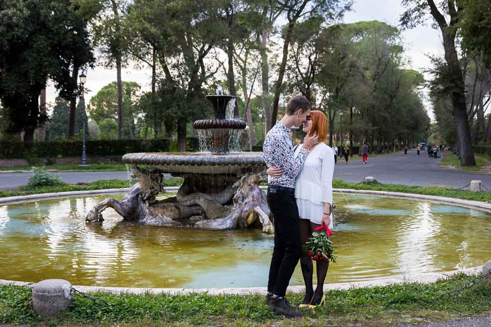 Love and romance close together before a fountain in the Borghese park