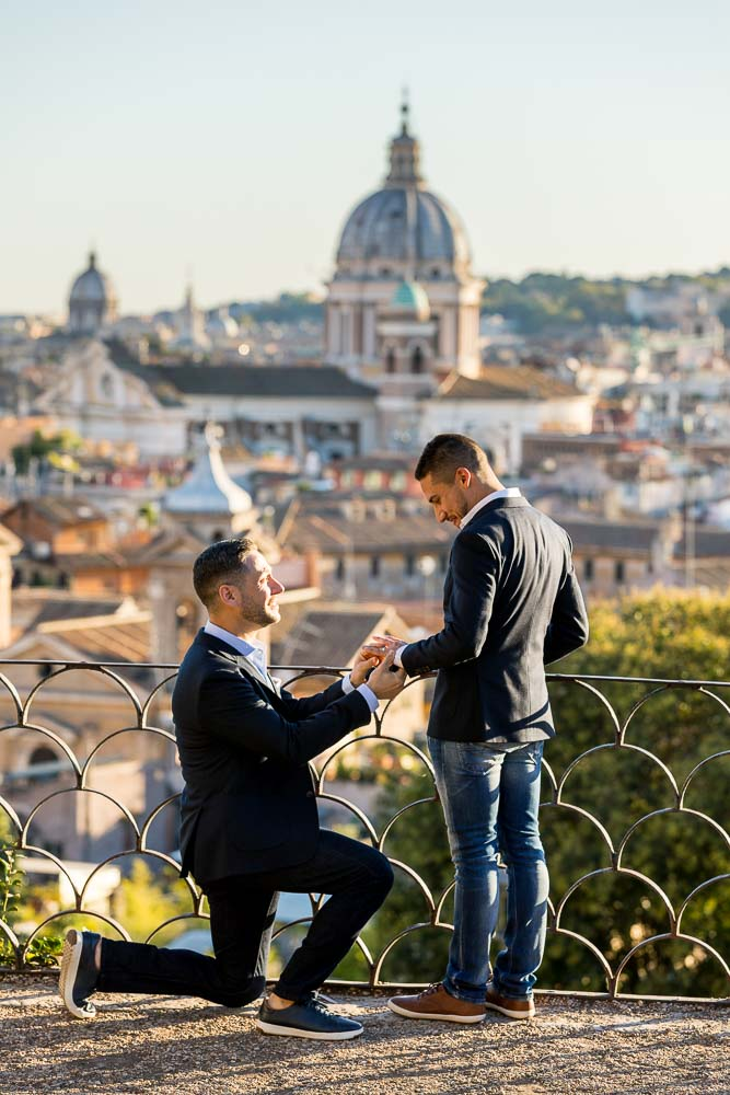 Same sex wedding marriage proposal overlooking the beautiful roman skyline from the Pincio park overlook