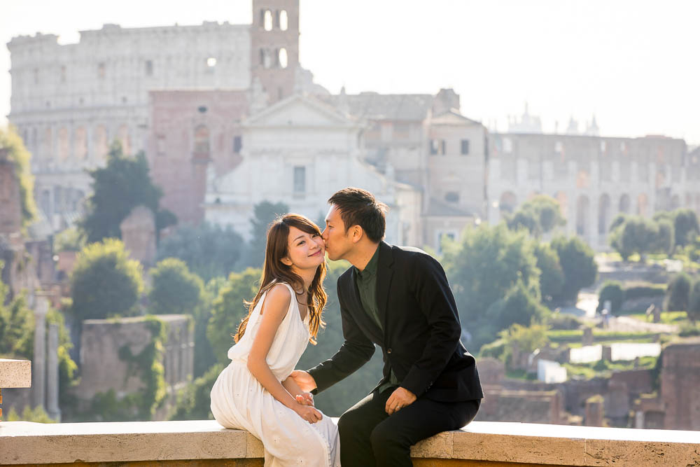 Romantic picture of a couple kissing in the ancient roman city
