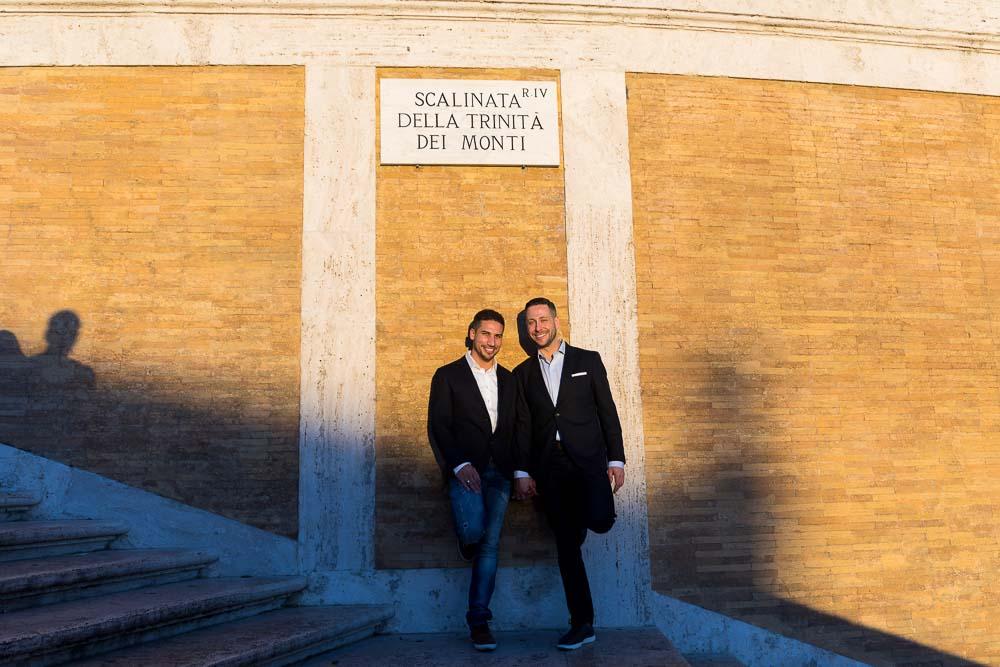 Portrait picture standing underneath the Scalinata della Trinita' dei Monti sign