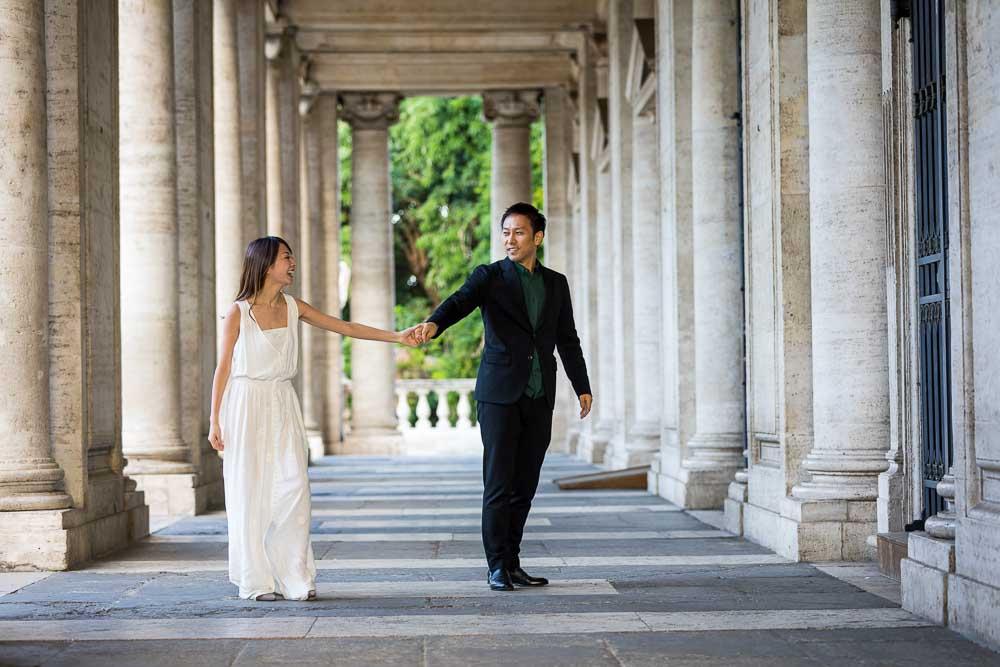 Hand in hand under marble columns