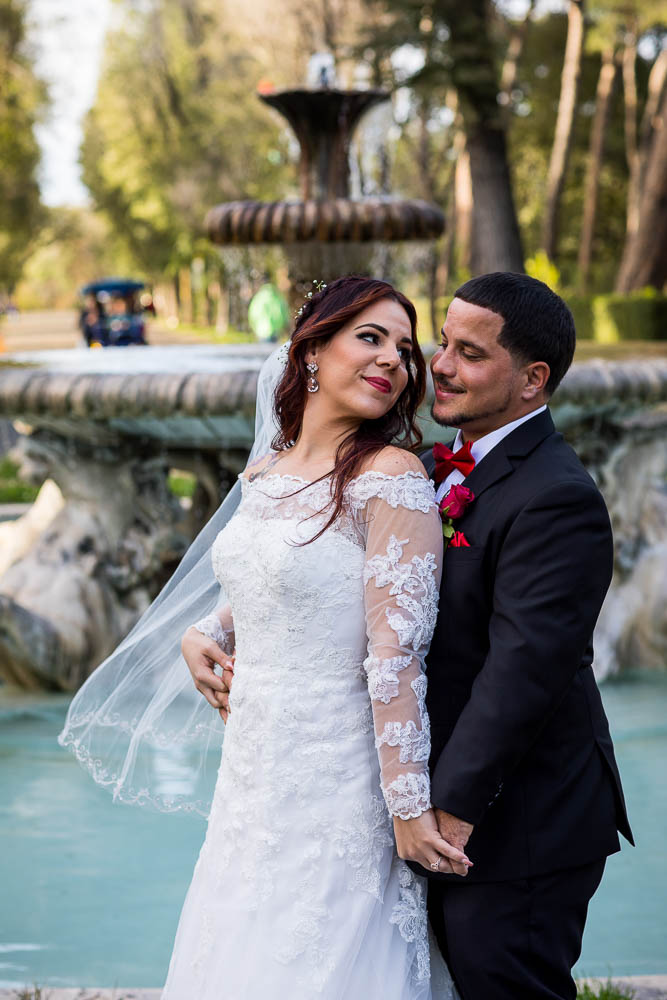 Bride and Groom looking at each other during the photography session portraits in Villa Borghese Park
