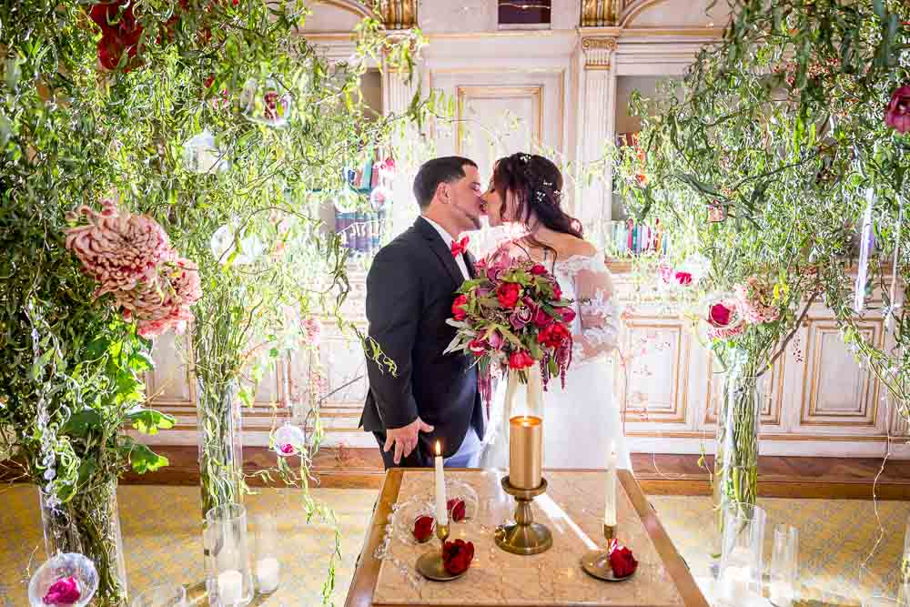 Just married bride and groom kissing after the private ceremony