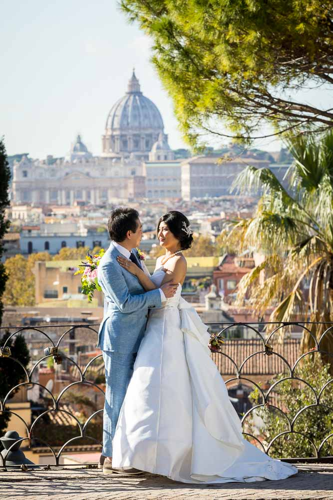 Posing together in front of the sweeping view of Rome and Saint Peter's cathedral in the far distance