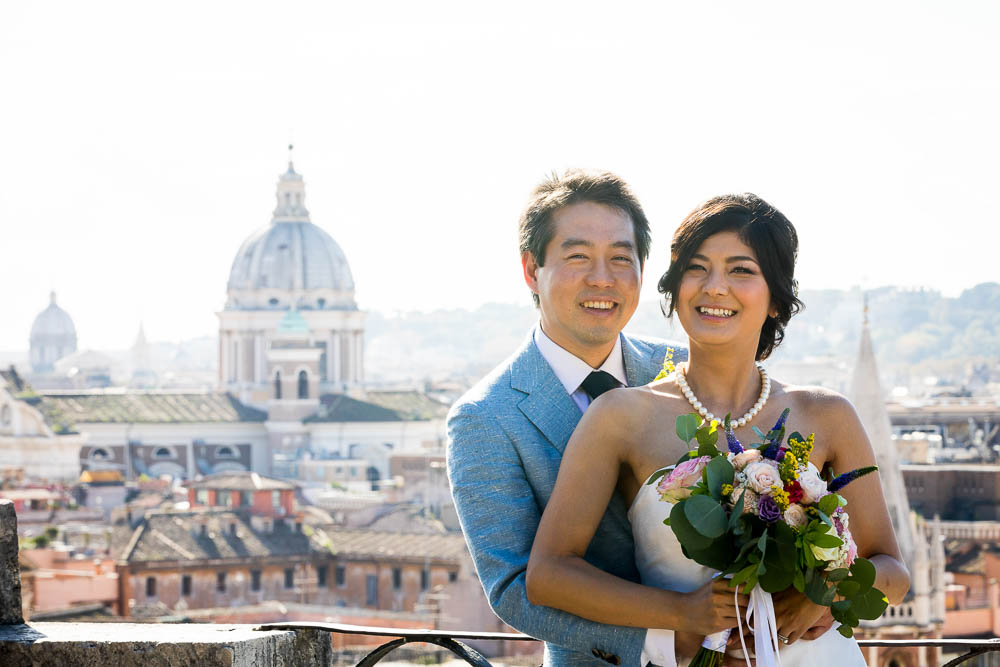Wedding portrait of a married couple celebrating marriage in the city of Rome Italy
