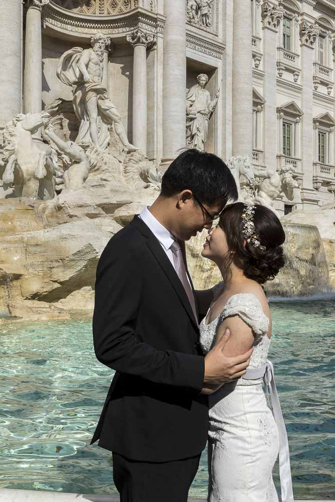 Bride and groom picture portrait photographed at the Trevi fountain in Rome Italy