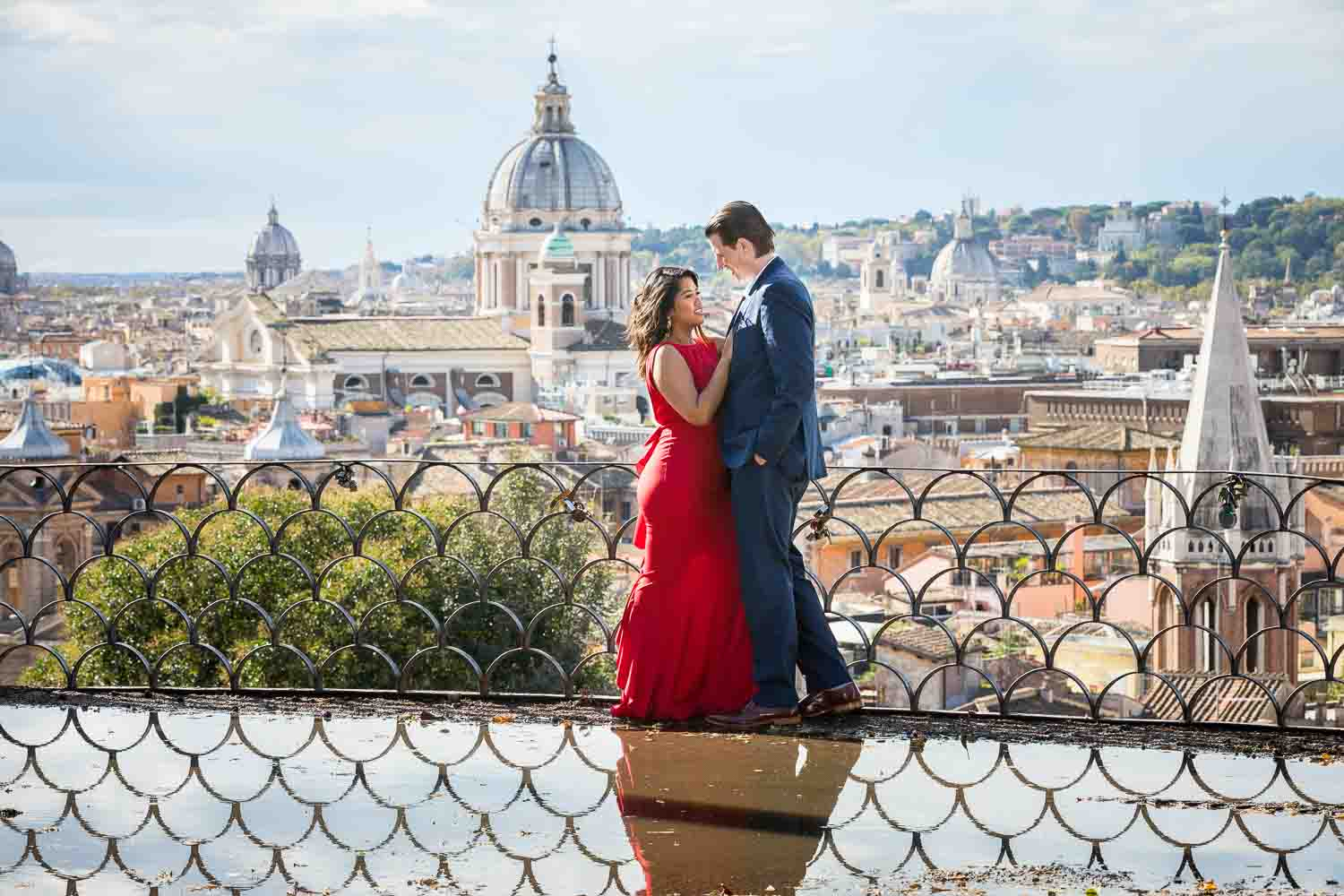 Couple taking photos in front of the sweeping view of the roman city from a nearby hill side view