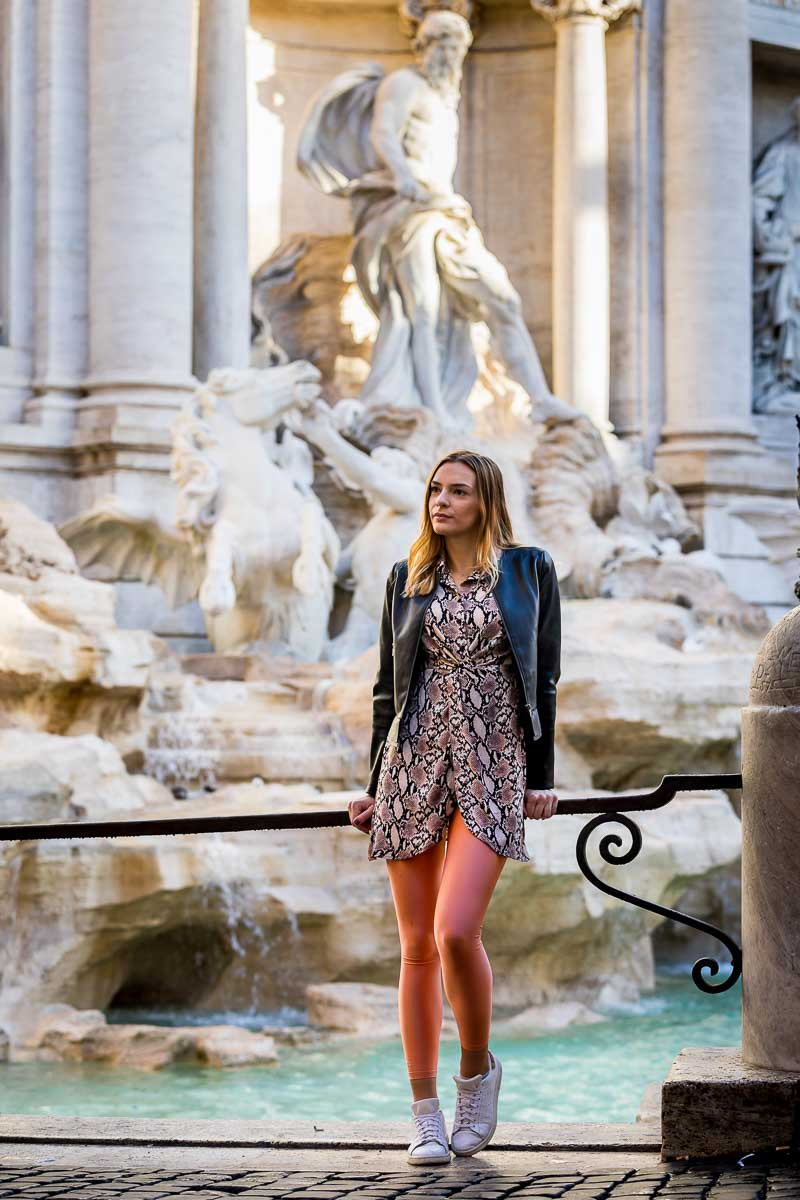 Standing in front of Fontana di Trevi in Rome Fashion Photography