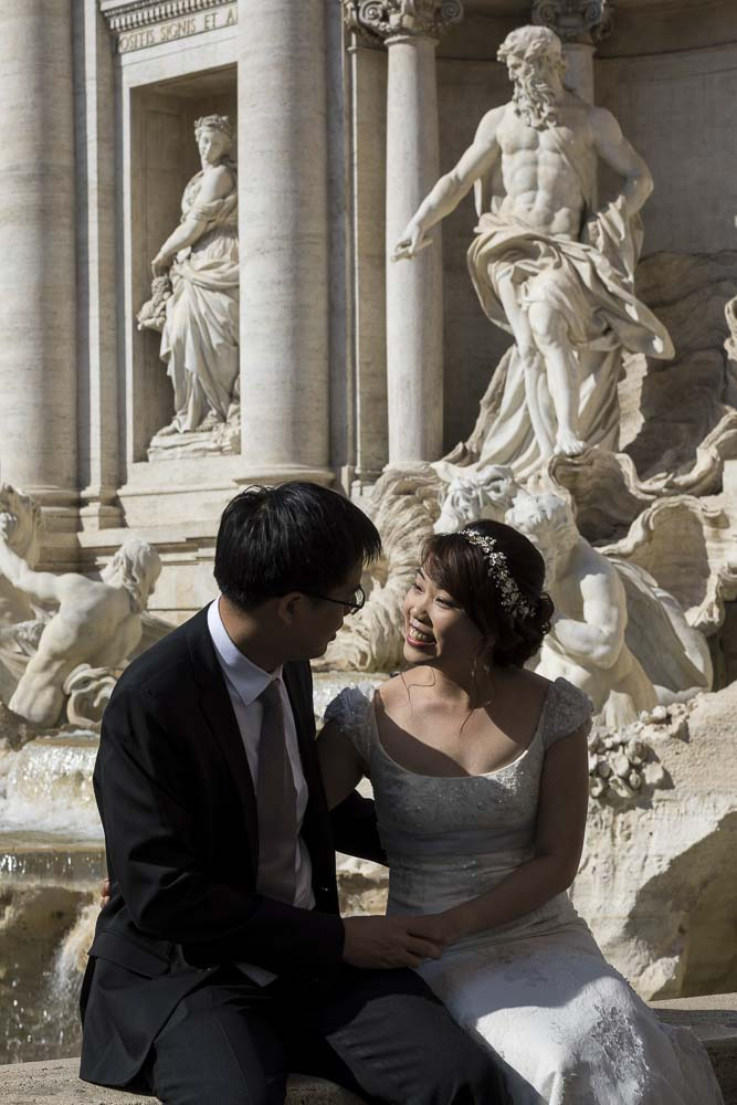 Sitting down portrait image of a wedding couple at Fontana di Trevi