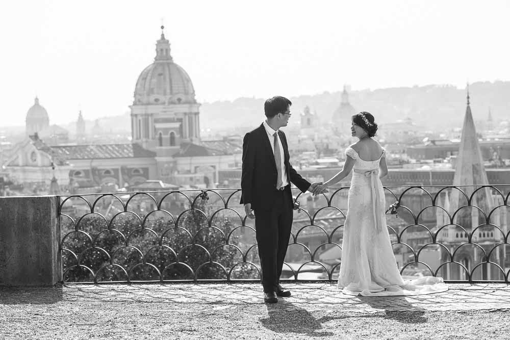 Black and white photography taken on the Pincio terrace park overlooking the city of Rome from above