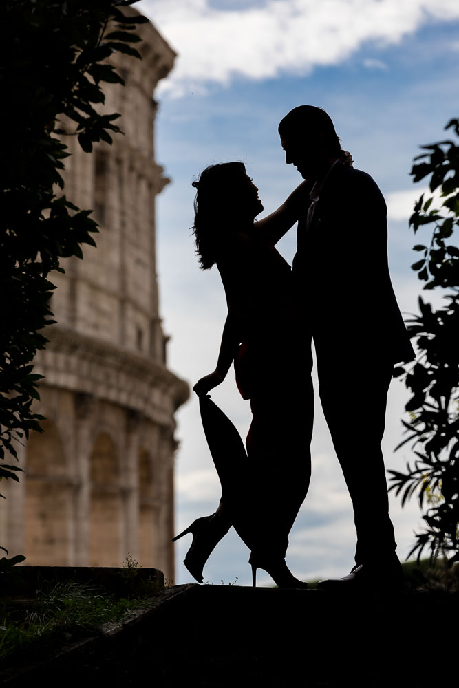 Silhouette image of a couple posing in front of the Roman Coliseum