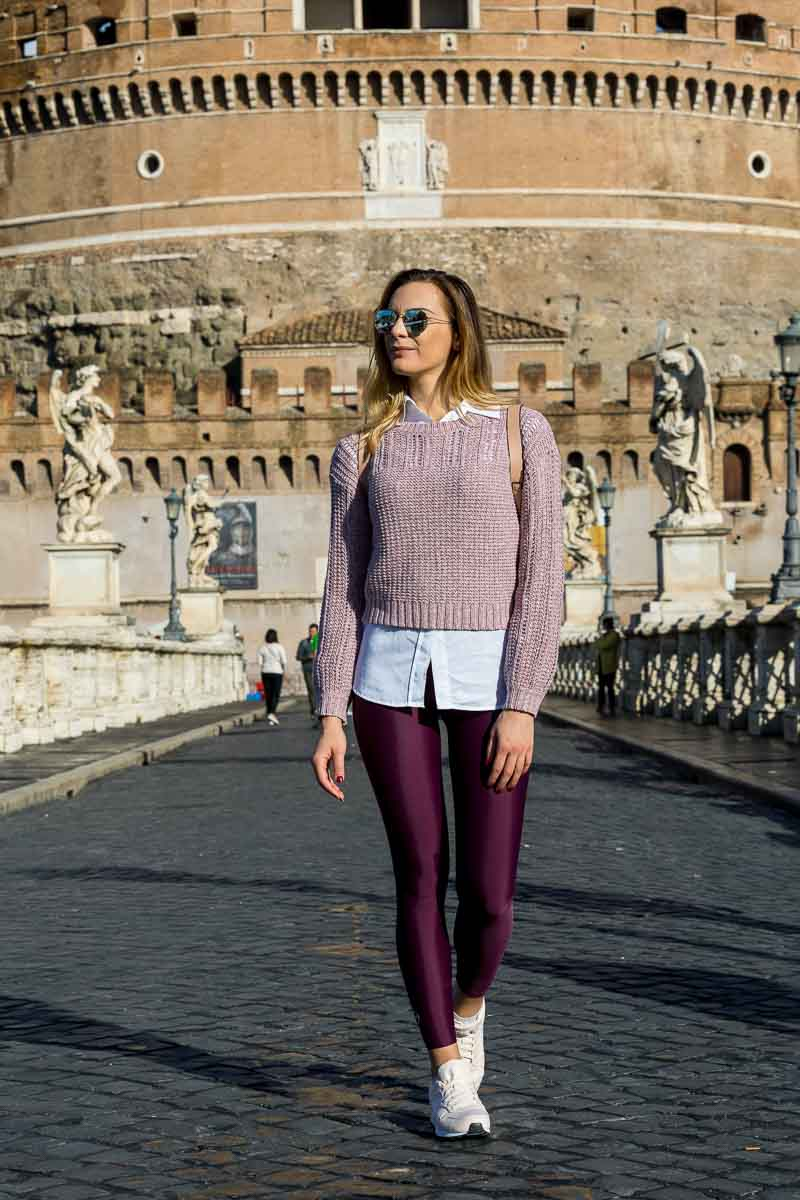 Model walking on Castel Sant'Angelo bridge in the early morning