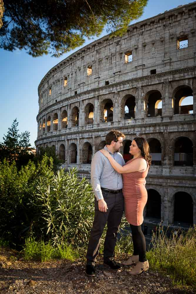 Posed engagement image in front of the coliseum