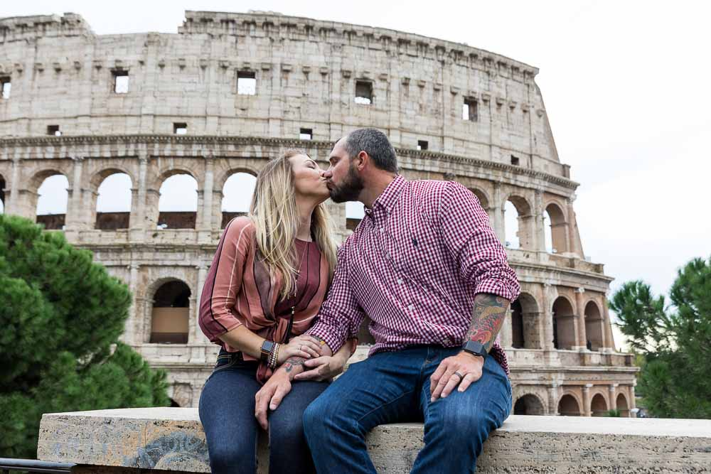 Kissing at the Roman Colosseum in Rome Italy