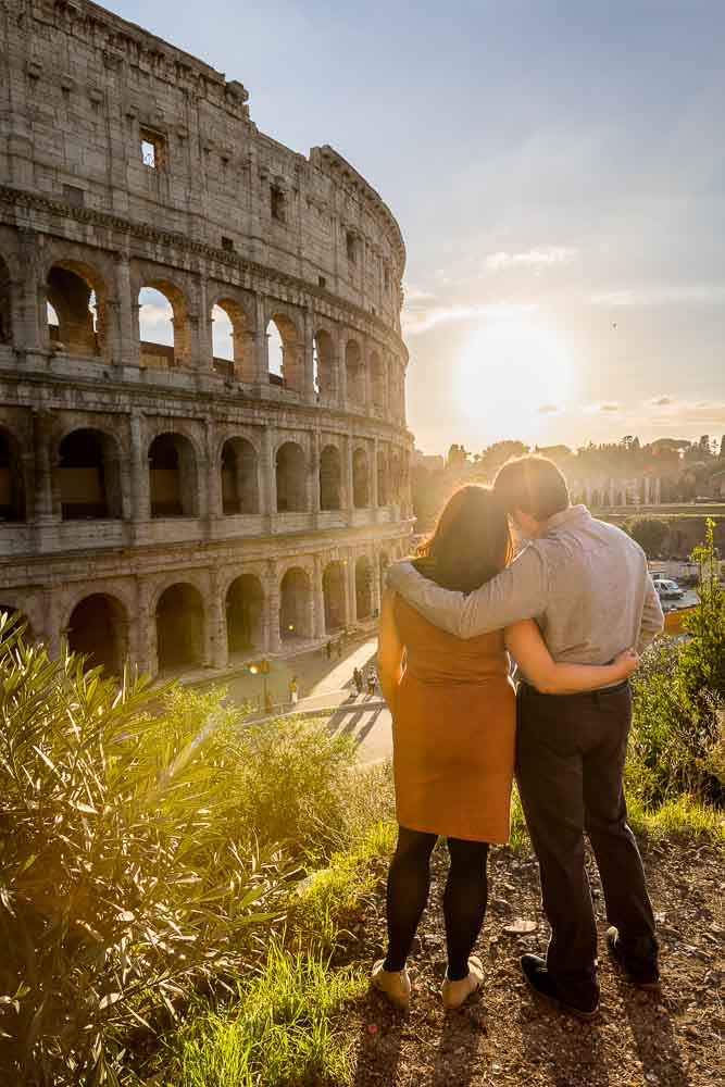 Romantic Couple Photography while looking at the sunset by the colosseum