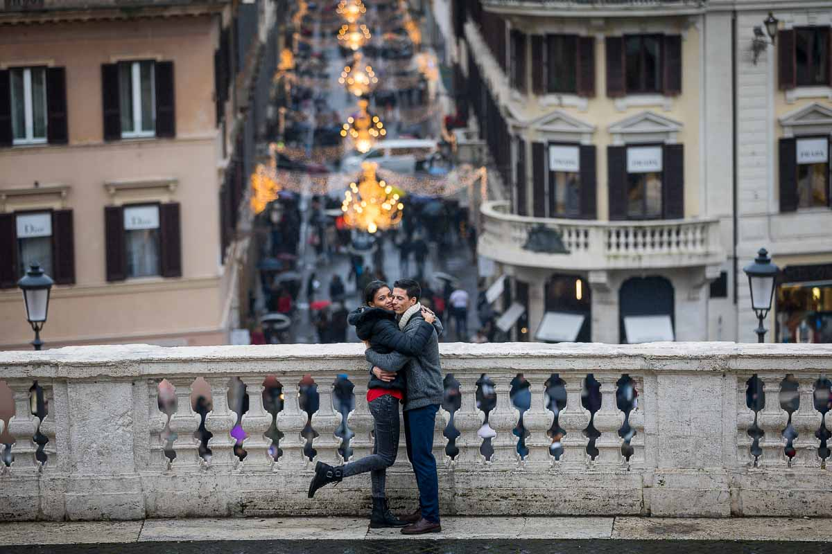 Couple photoshoot with Via Condotti embellished with beautiful Christmas lights