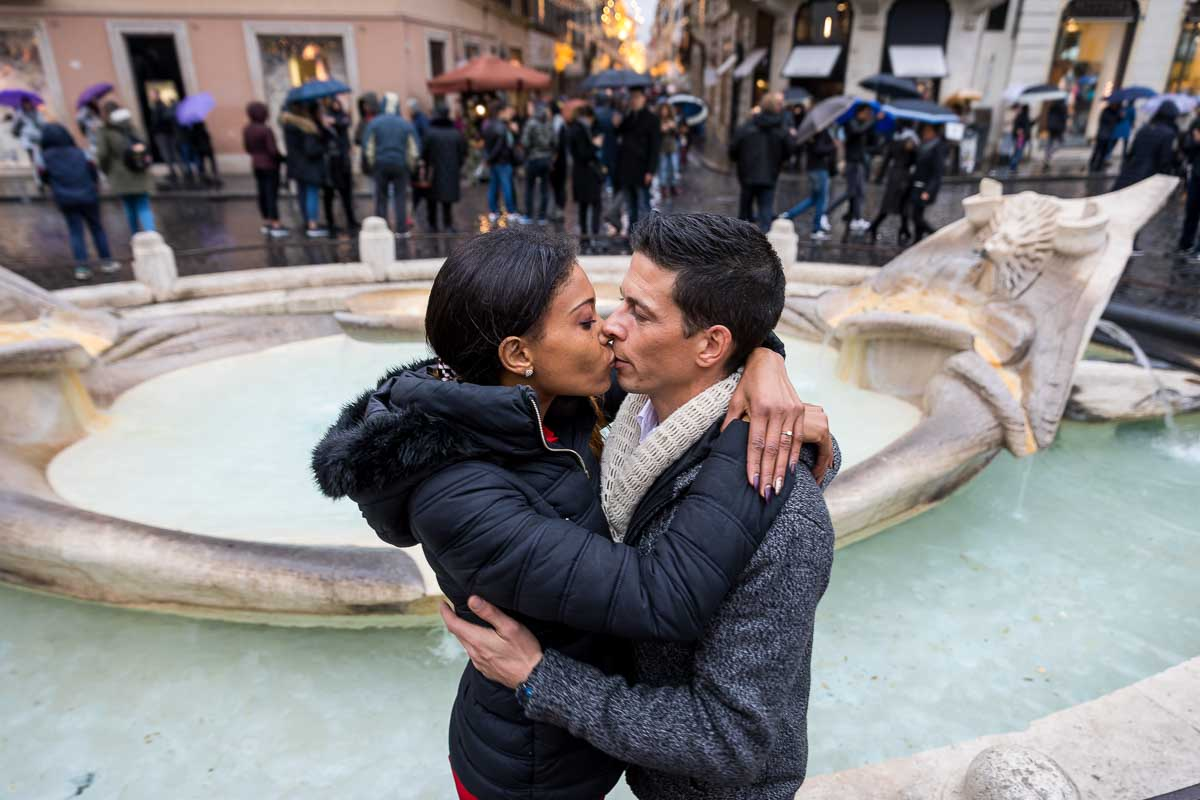 Love story photo session by the Barcaccia water fountain found at the foot of the Spanish Steps