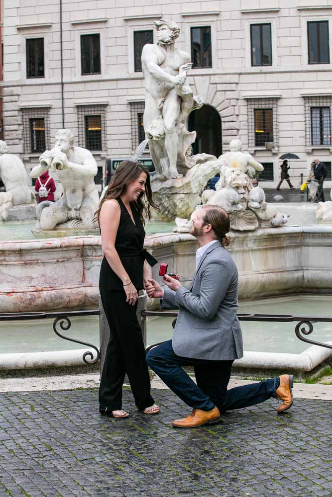Knee down wedding marriage proposal in the city of Rome