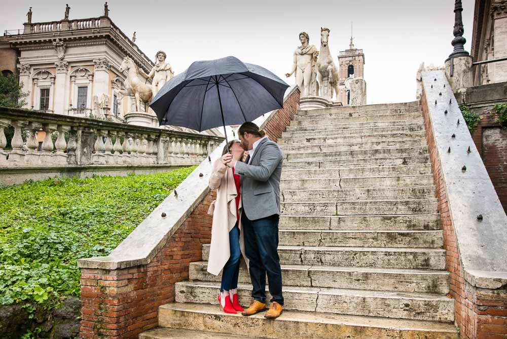 Engagement photo shoot in Rome under the rain with an umbrella