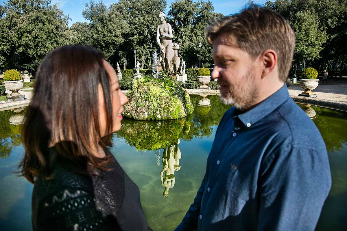 Couple reflection image during a photo session in Villa Borghese park in Rome