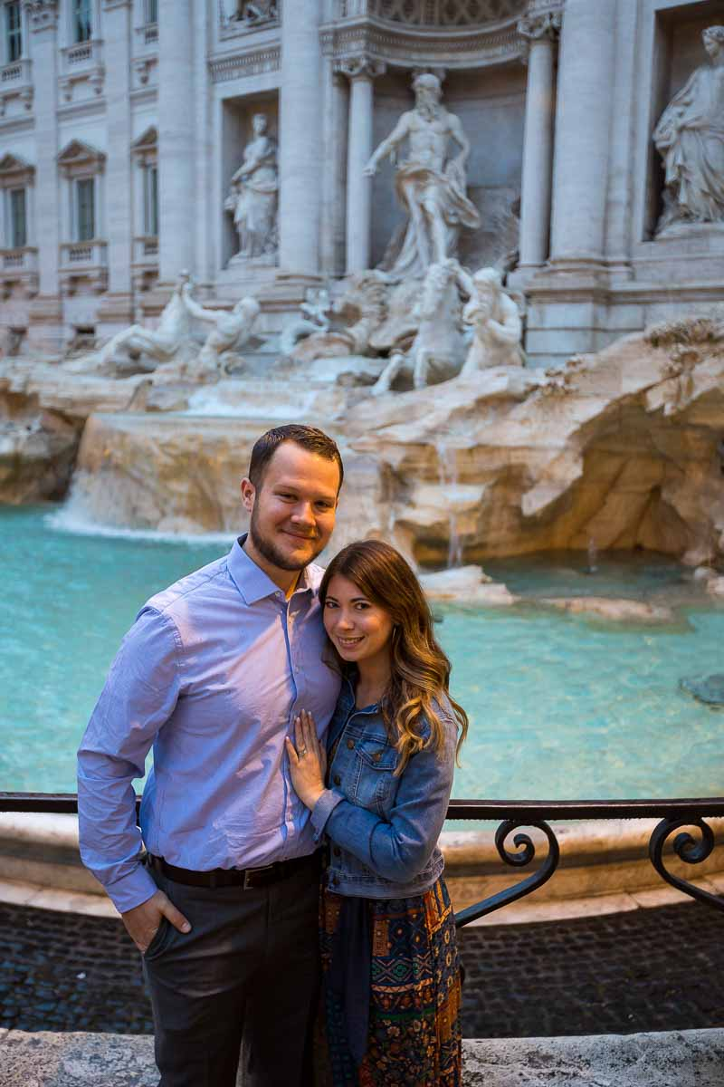 Couple portrait posed in front of the Trevi fountain