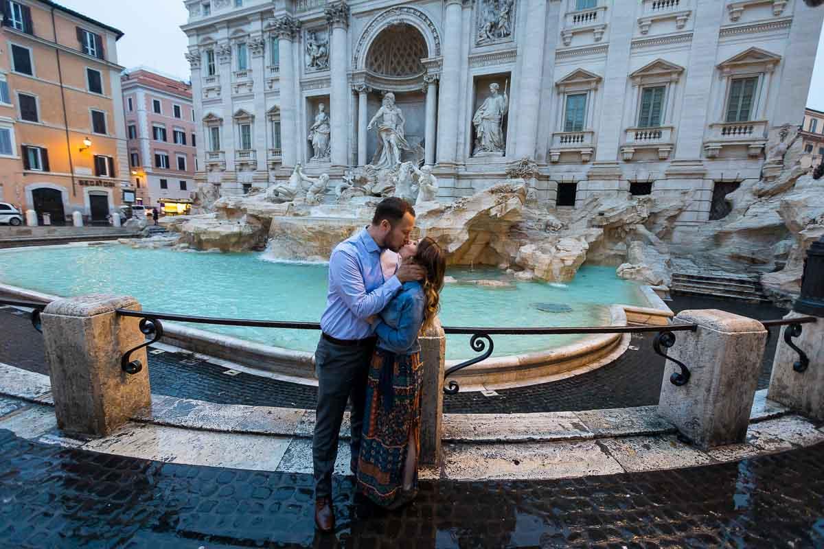 Kissing at Fontana di Trevi. Wide angle shot